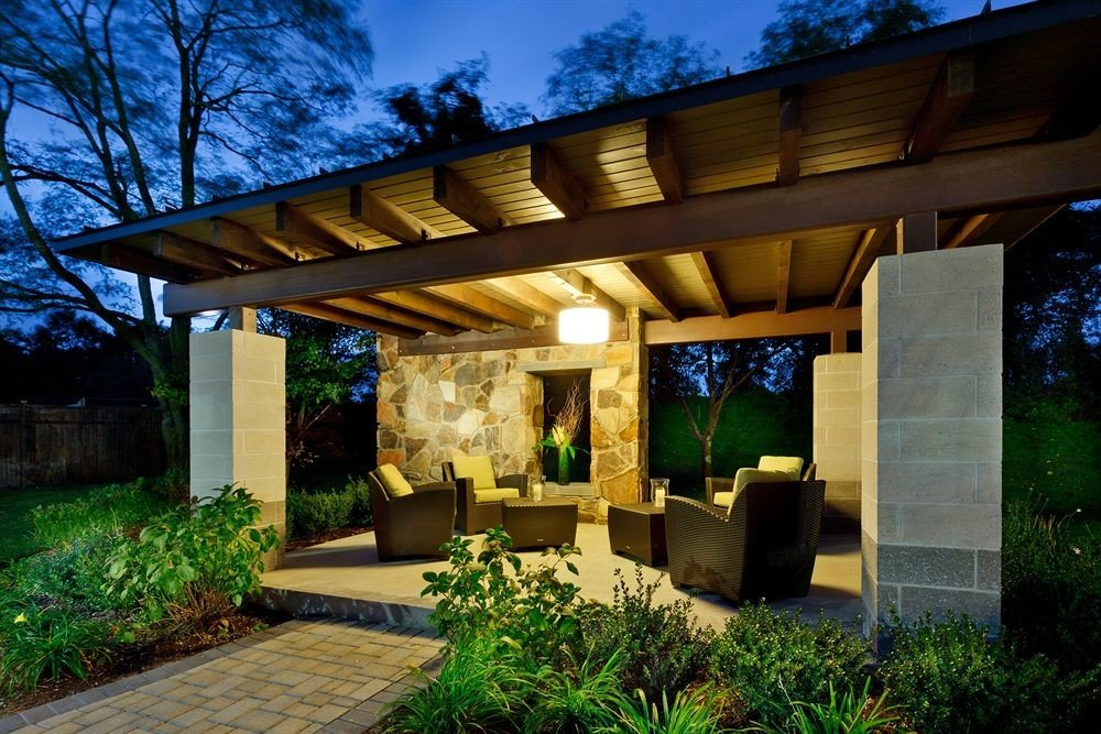 tree grass building property house home backyard pergola outdoor structure Courtyard landscape lighting Villa cottage porch stone