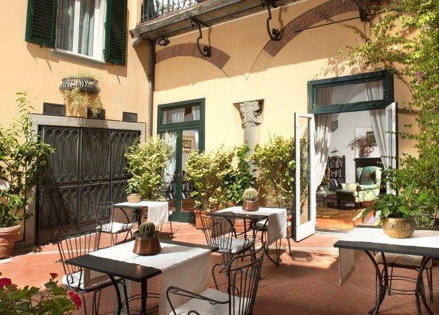 property chair Villa home condominium cottage outdoor structure Courtyard backyard hacienda dining table