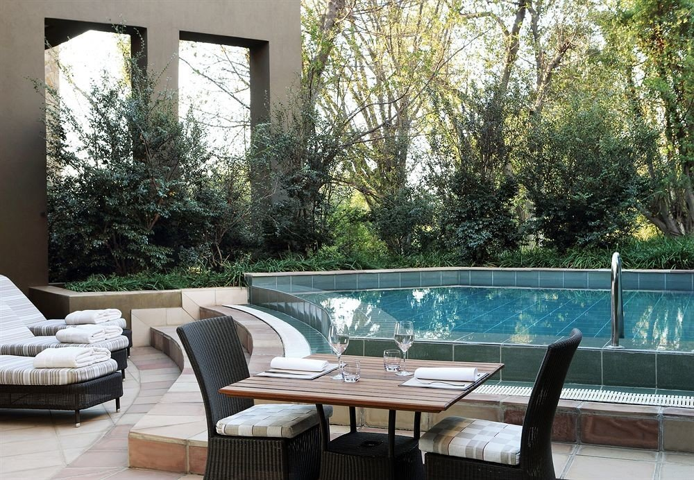 tree property swimming pool backyard Villa home cottage Courtyard outdoor structure condominium dining table