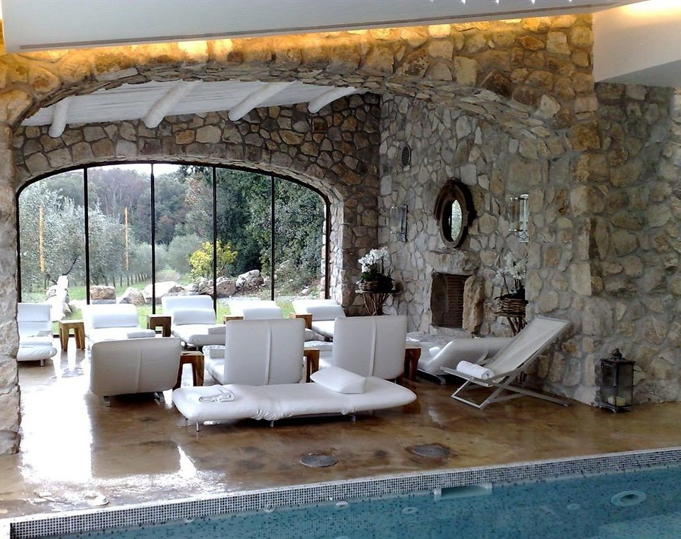property Villa living room swimming pool home hacienda cottage stone mansion backyard Courtyard