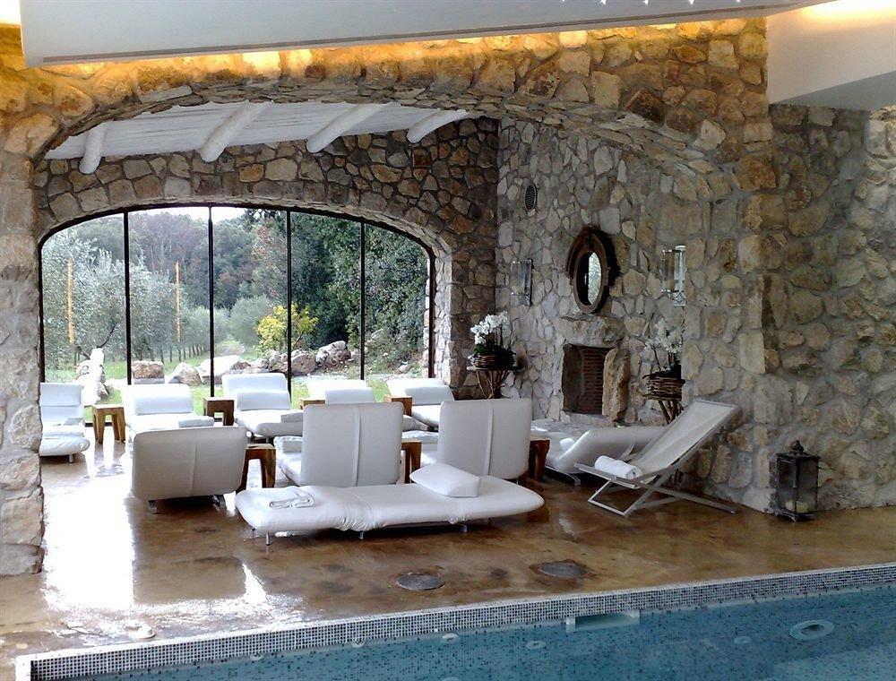 property Villa living room swimming pool home hacienda cottage stone mansion backyard Courtyard