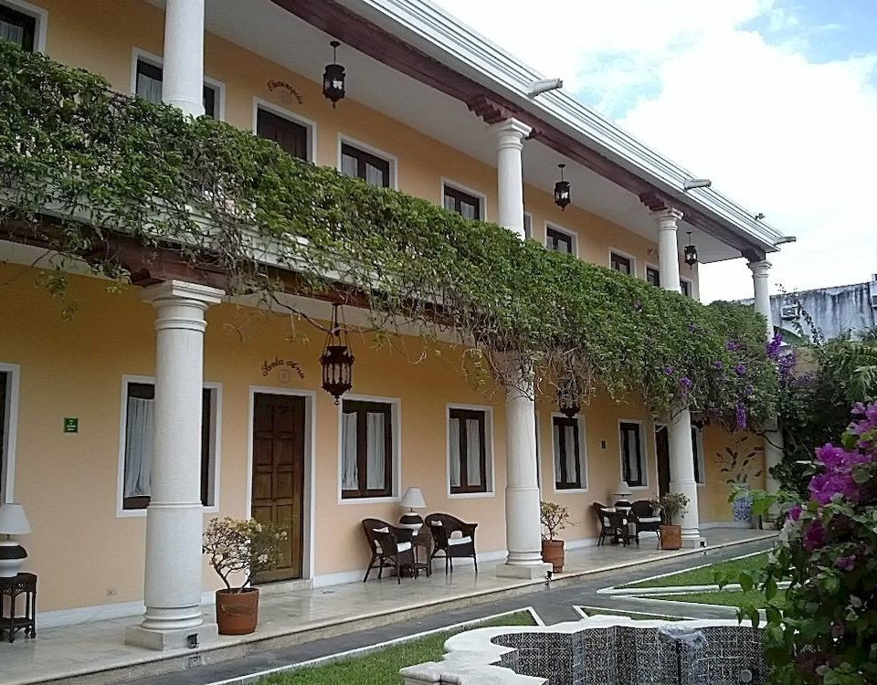 building property house neighbourhood Courtyard home residential area Villa condominium stone colonnade