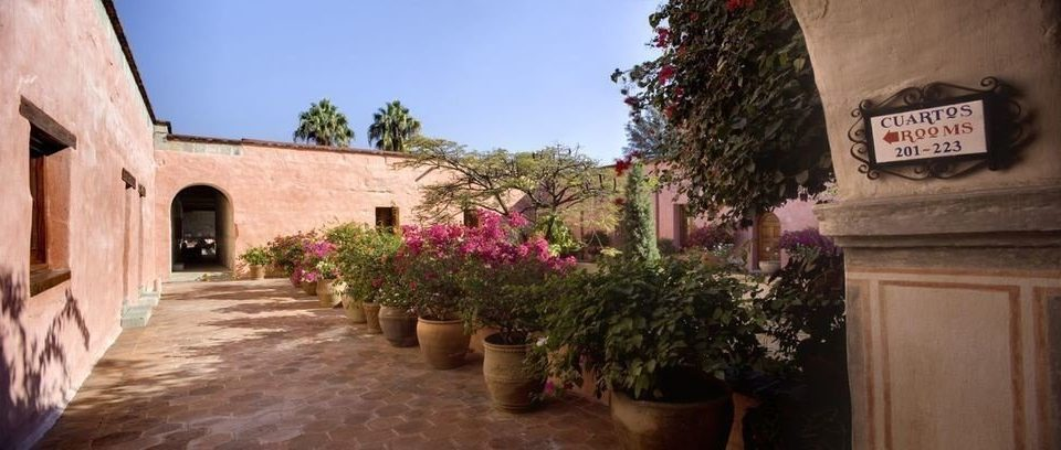 building property house home hacienda cottage Villa Courtyard Village stone arch