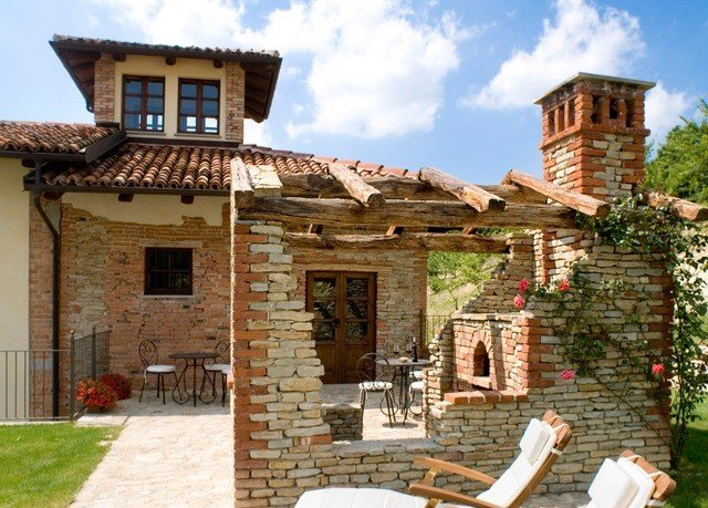 building sky house property brick home stone Villa medieval architecture historic site cottage hacienda outdoor structure Village Courtyard roof stone wall building material