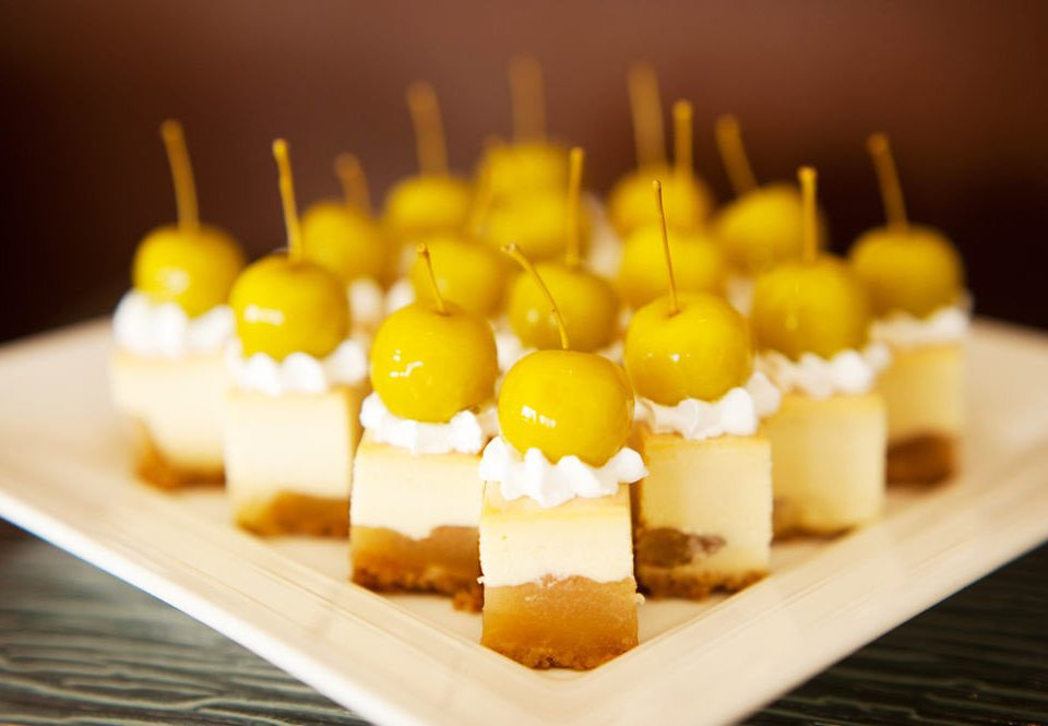 food yellow dessert plant land plant sweetness fruit flowering plant pastry flavor petit four cuisine