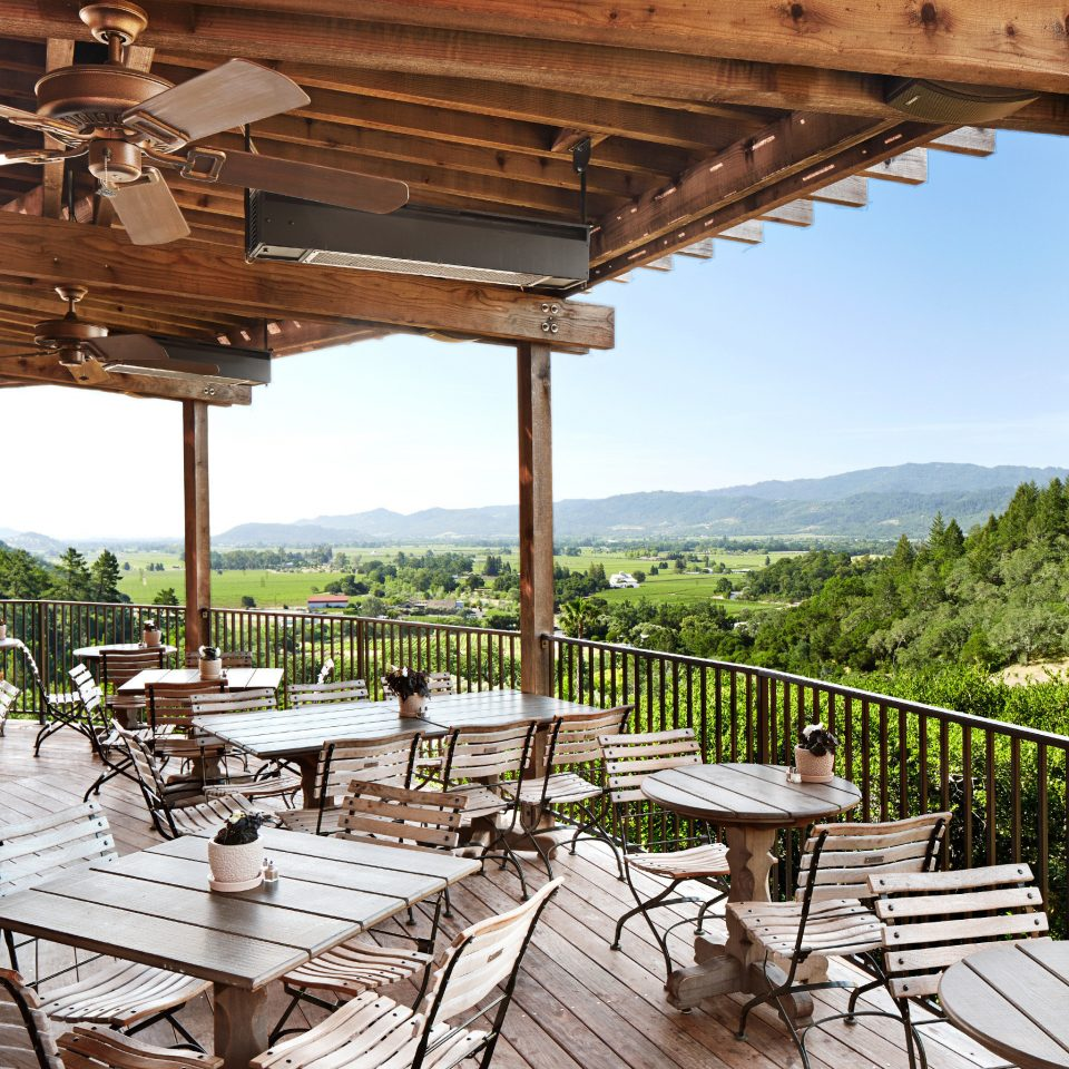 Cultural Dining Drink Eat Grounds Honeymoon Luxury Mountains Natural wonders Outdoor Activities Outdoors Resort Romance Romantic Scenic views Spa Vineyard Winery chair wooden building Picnic outdoor structure porch pergola Villa cottage set Deck overlooking colonnade
