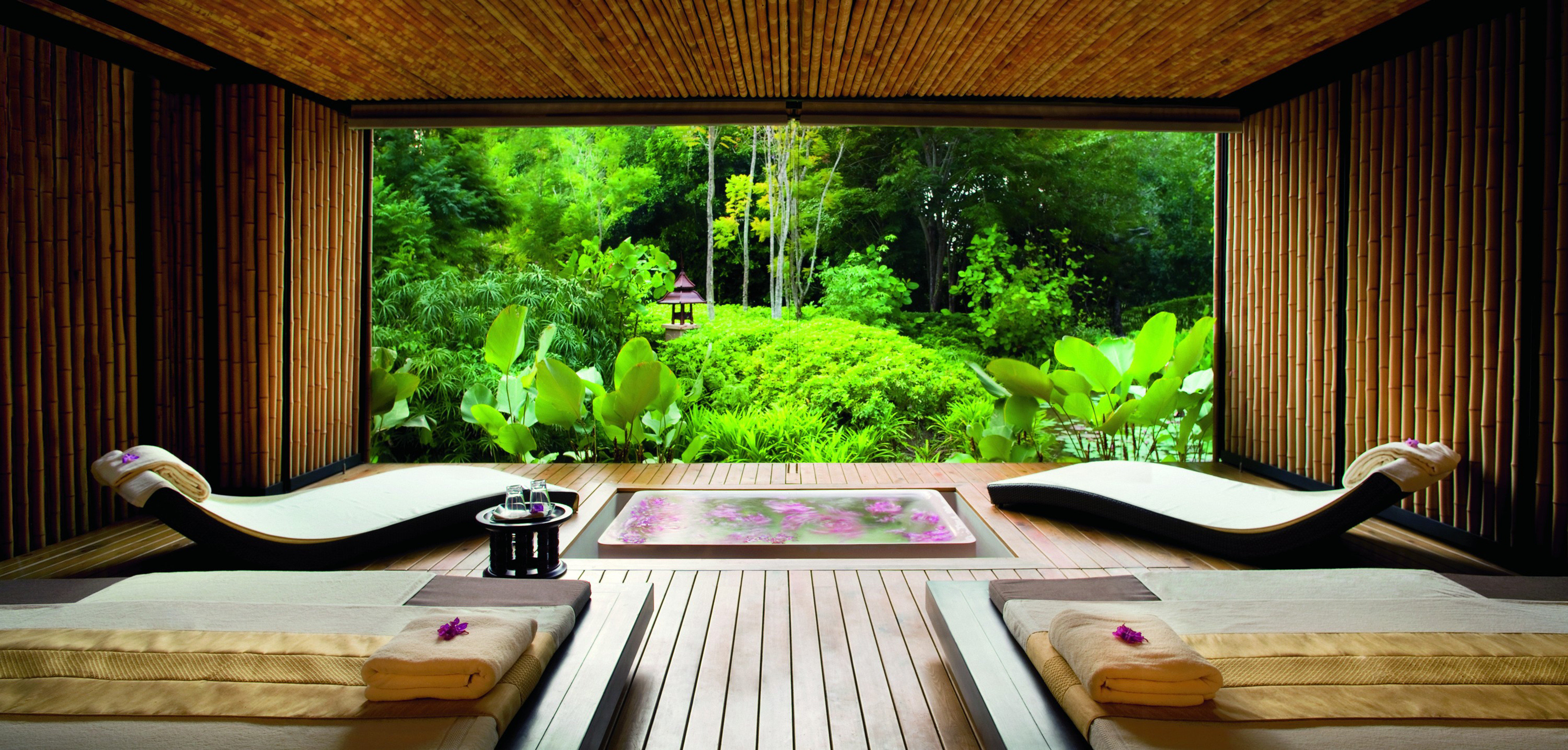 Cultural Deck Eco Elegant Honeymoon Jungle Luxury Nature Romance Romantic Spa Terrace Tropical Wellness property wooden house swimming pool home living room cottage Resort Villa backyard mansion Suite dining table