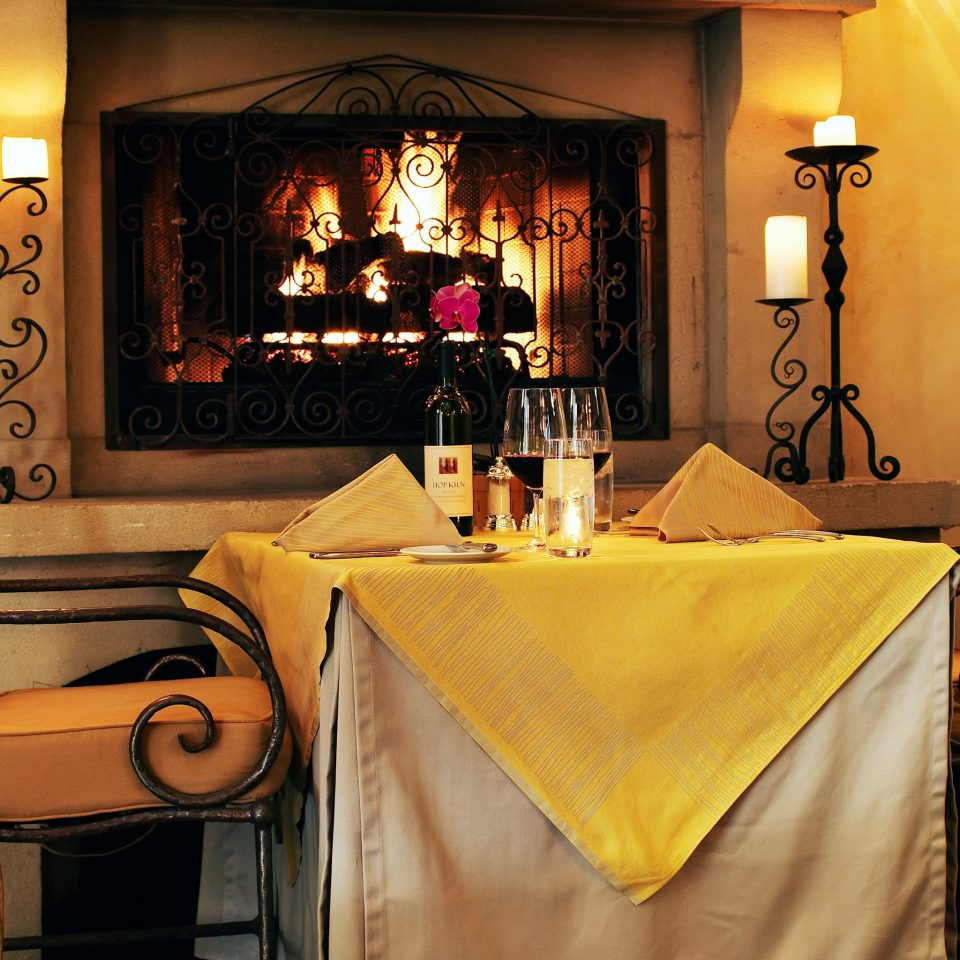 Cultural Dining Drink Eat Fireplace Romantic yellow restaurant home living room