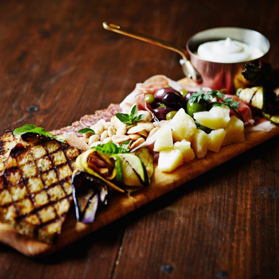 Cultural Dining Eat food wooden board slice land plant cuisine breakfast flowering plant sliced