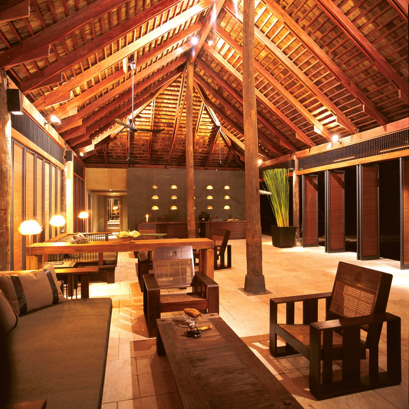 Cultural Eco Elegant Jungle Lobby Lounge Nature Tropical chair building home Resort log cabin living room restaurant outdoor structure