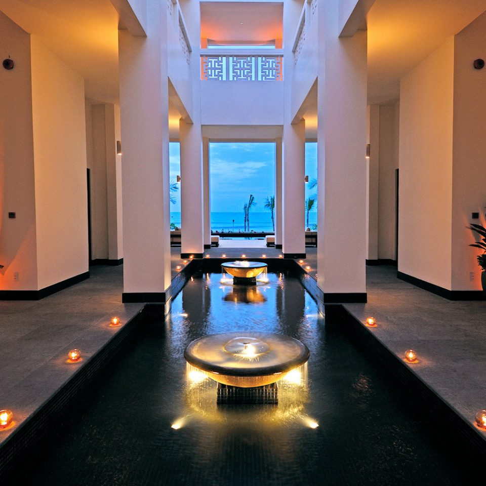Cultural Eco Jungle Luxury Nature Ocean Romantic Scenic views Sea Spa Tropical Waterfront Wellness lighting orange Suite Lobby light