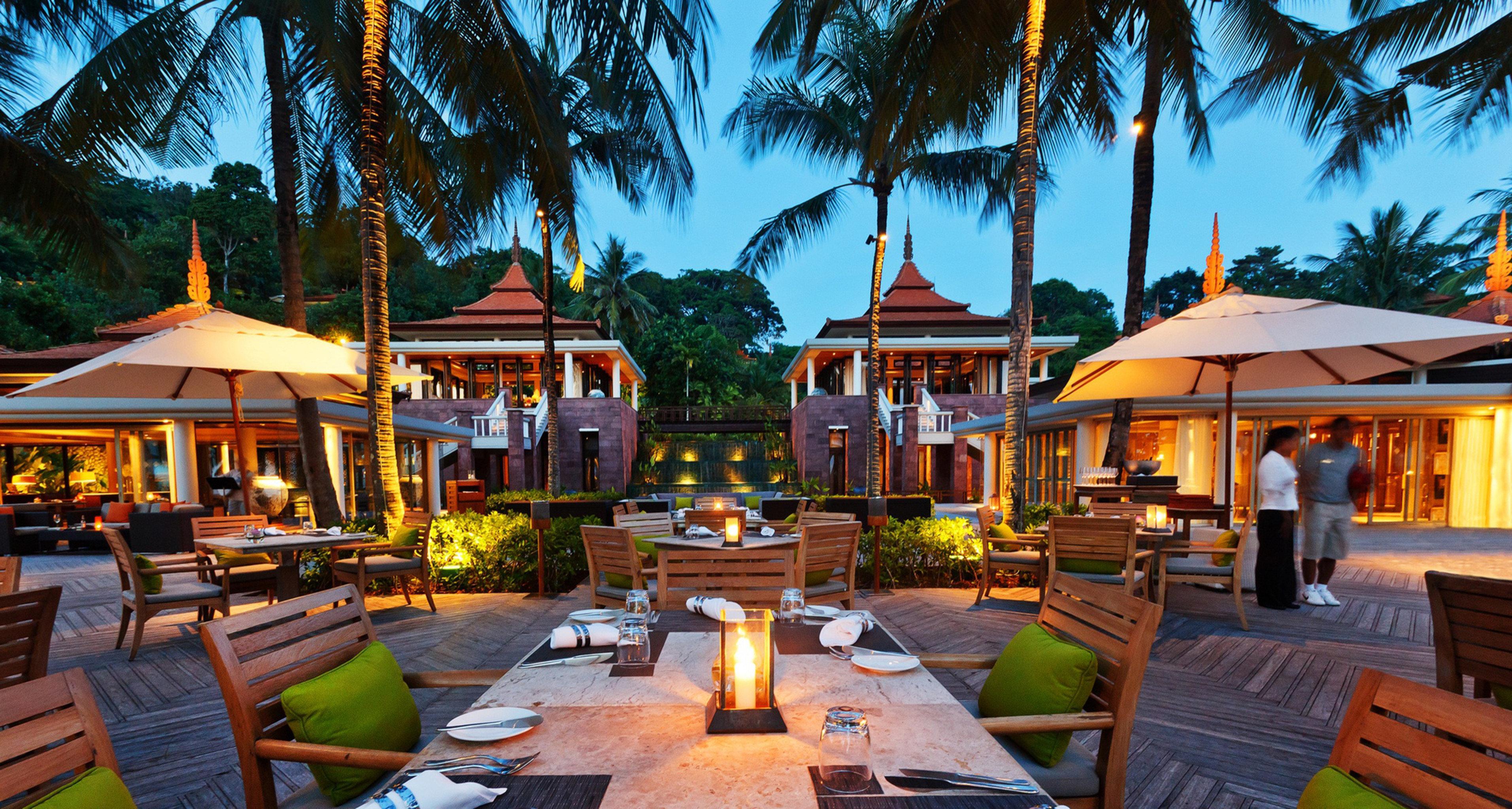 Bar Beach Dining Drink Eat Hotels Phuket Thailand Tropical tree outdoor leisure Resort estate vacation home restaurant real estate Village set lined furniture several