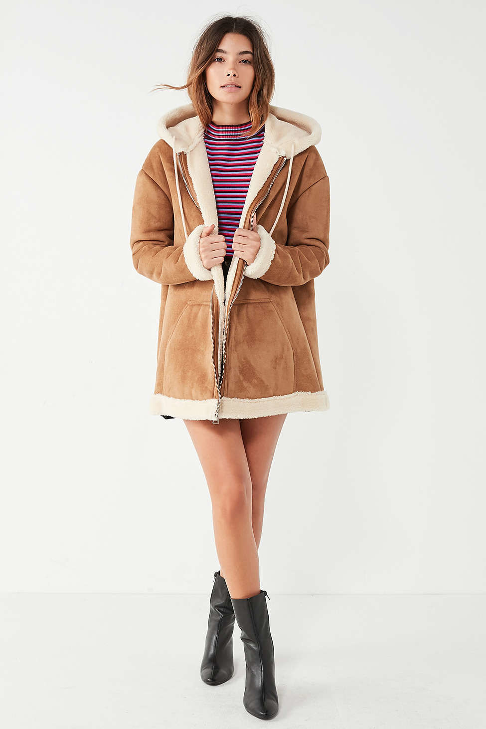 Style + Design Travel Shop person woman fashion model coat fur clothing fashion posing fur overcoat supermodel dressed tan