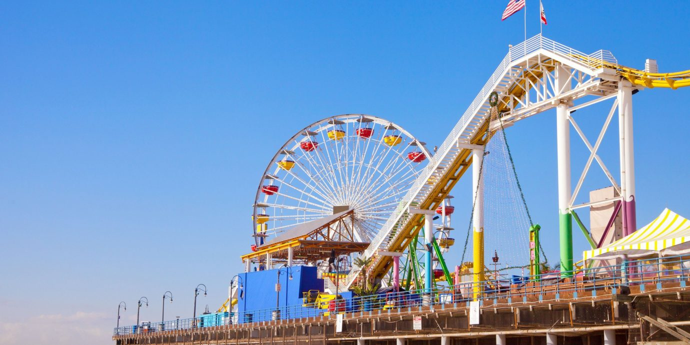 Beach sky outdoor leisure amusement park ferris wheel walkway outdoor recreation pier boardwalk park Sea nonbuilding structure tourist attraction fair amusement ride ride
