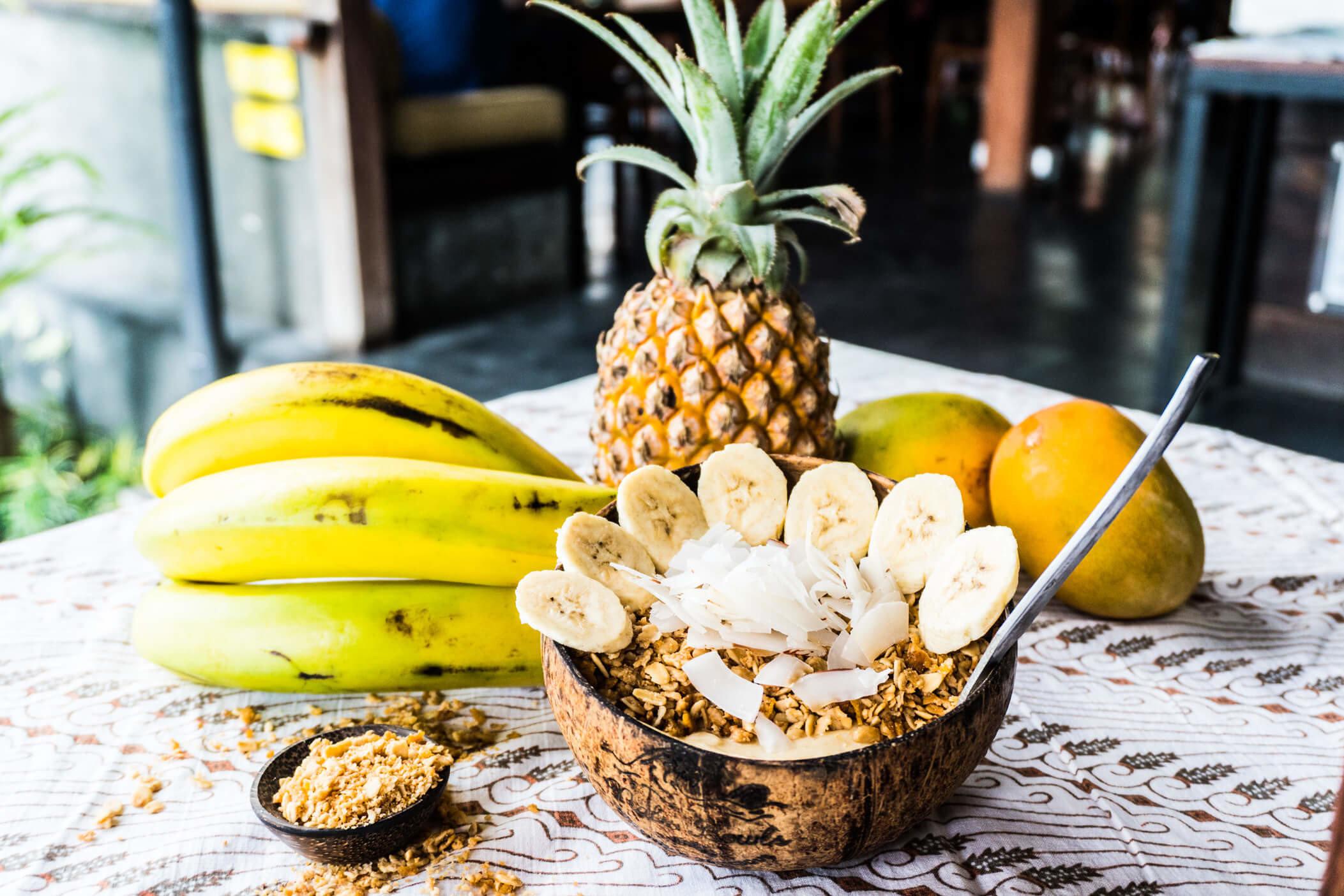 Influencers + Tastemakers Travel Shop Trip Ideas table ananas food fruit pineapple banana banana family produce vegetarian food vegetable bromeliaceae superfood fresh