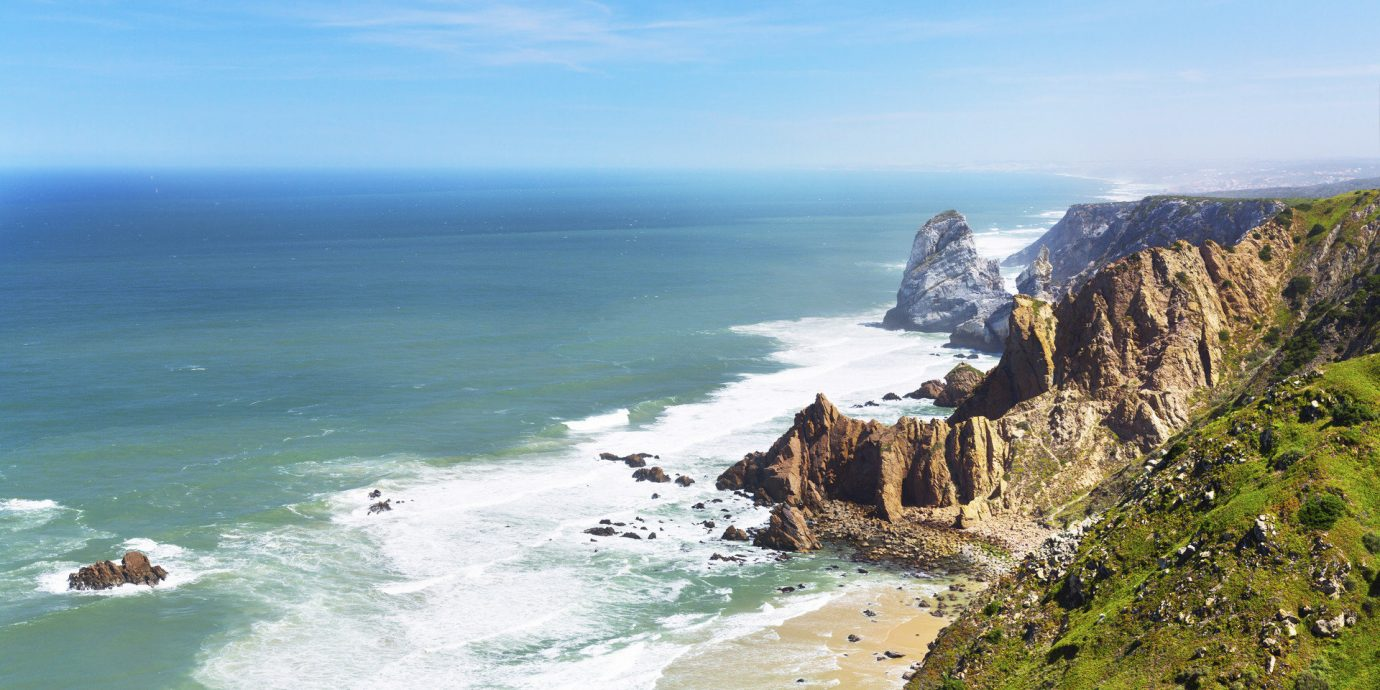 Trip Ideas outdoor sky water Nature mountain Coast cliff Sea Ocean shore landform body of water geographical feature headland horizon terrain Beach rocky vacation wind wave wave cape rock bay cove hill material hillside lush