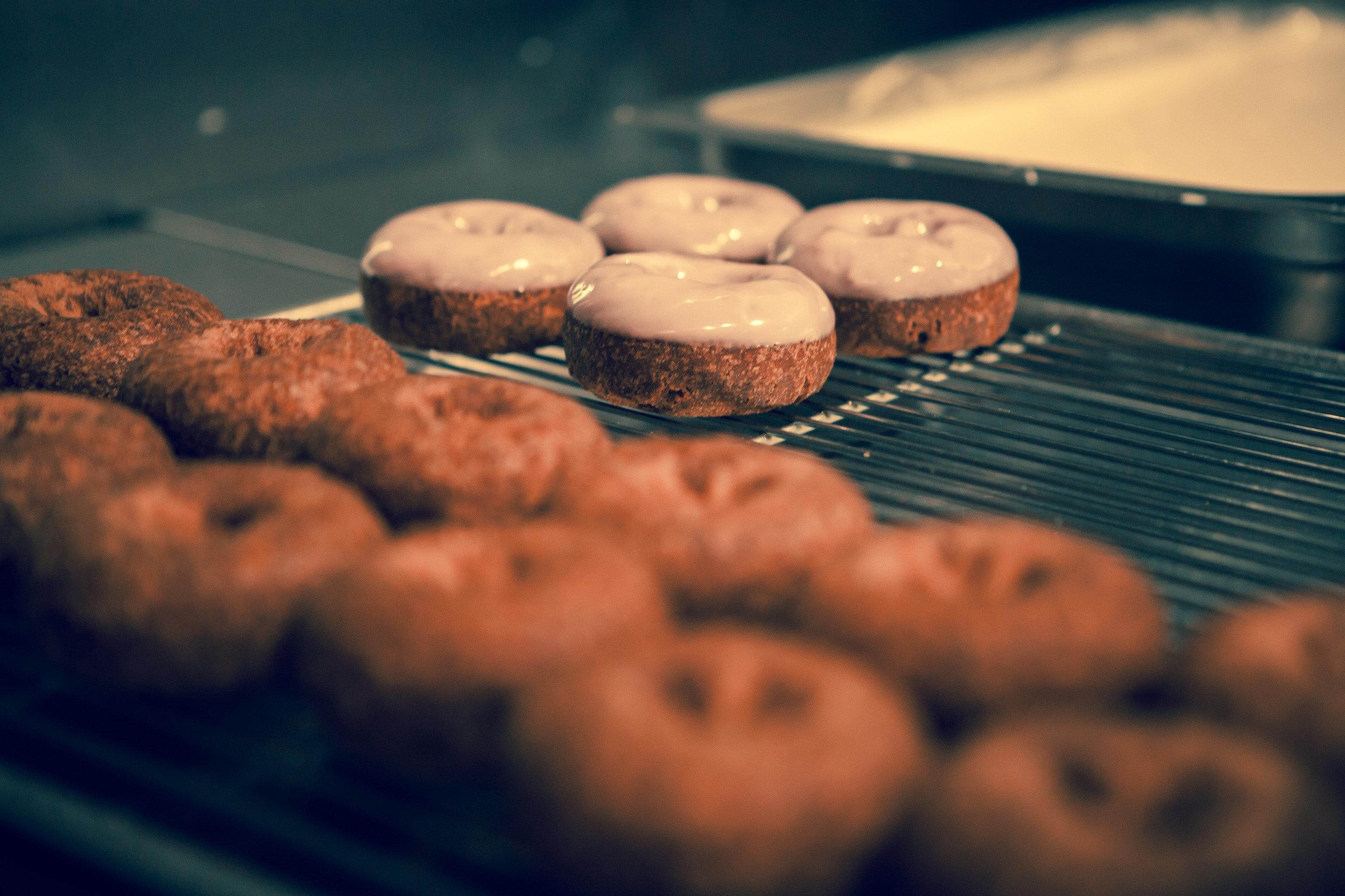 Food + Drink Style + Design Trip Ideas Weekend Getaways doughnut donut indoor baking sweetness close up cookies and crackers chocolate baked goods flavor finger food food snack dessert cookie close vegetable