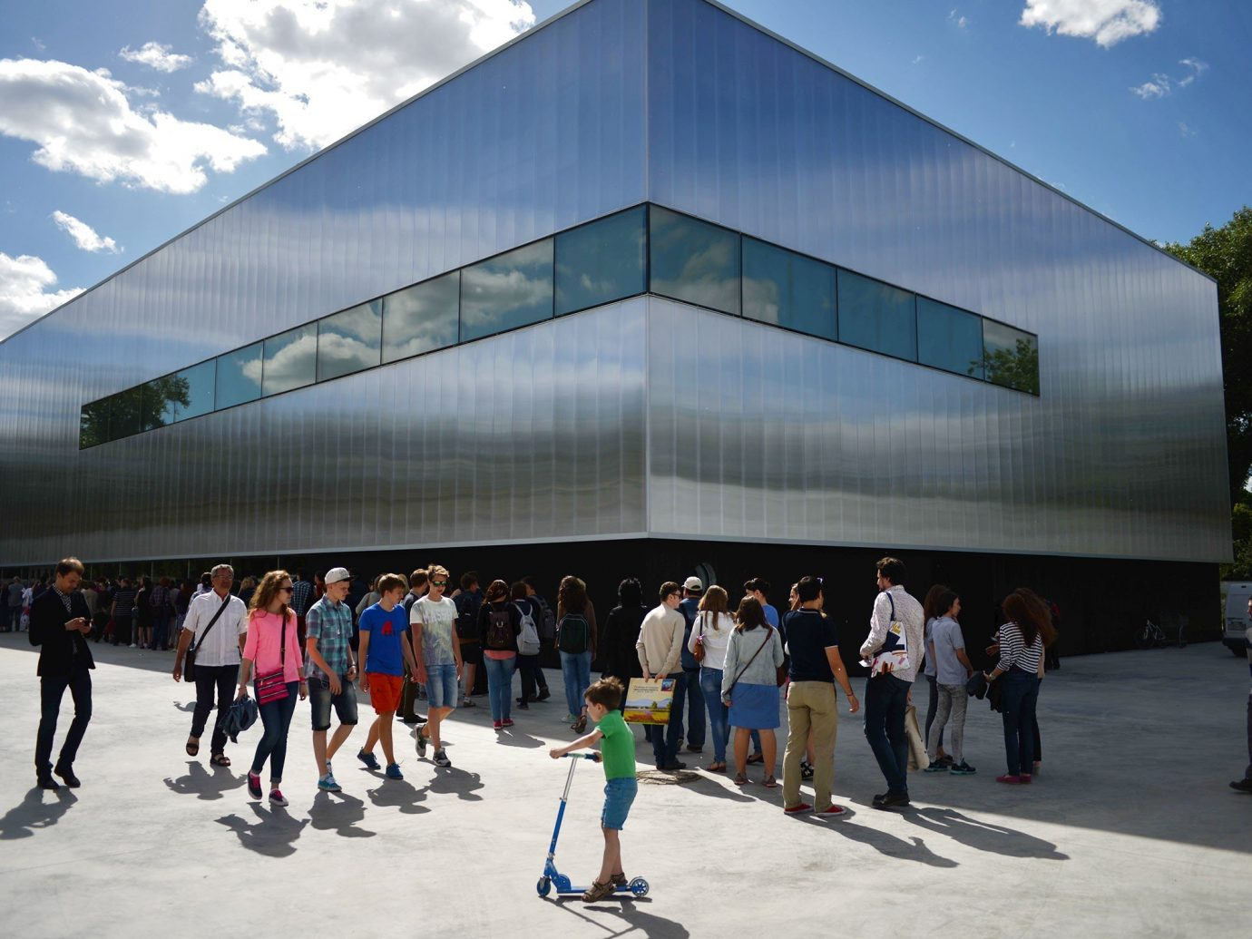 Arts + Culture sky outdoor building leisure Architecture people rink ice rink arena campus headquarters crowd