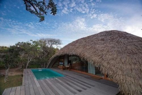 sky property ecosystem swimming pool hut roof day