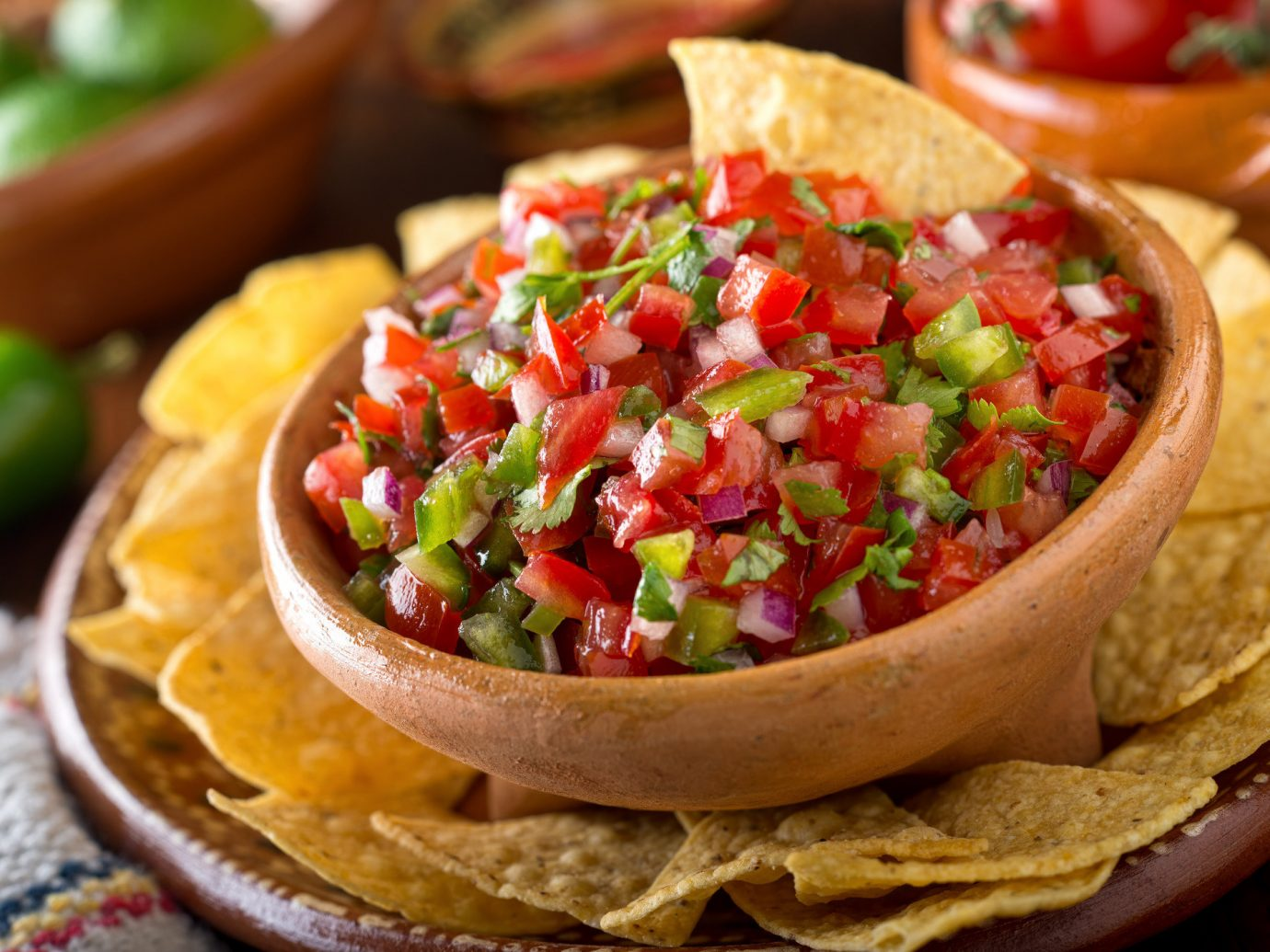 Food + Drink food dish tostada cuisine tortilla chip guacamole produce bruschetta salsa sauce land plant pico de gallo vegetable dip taco flowering plant condiment bread meal toppings
