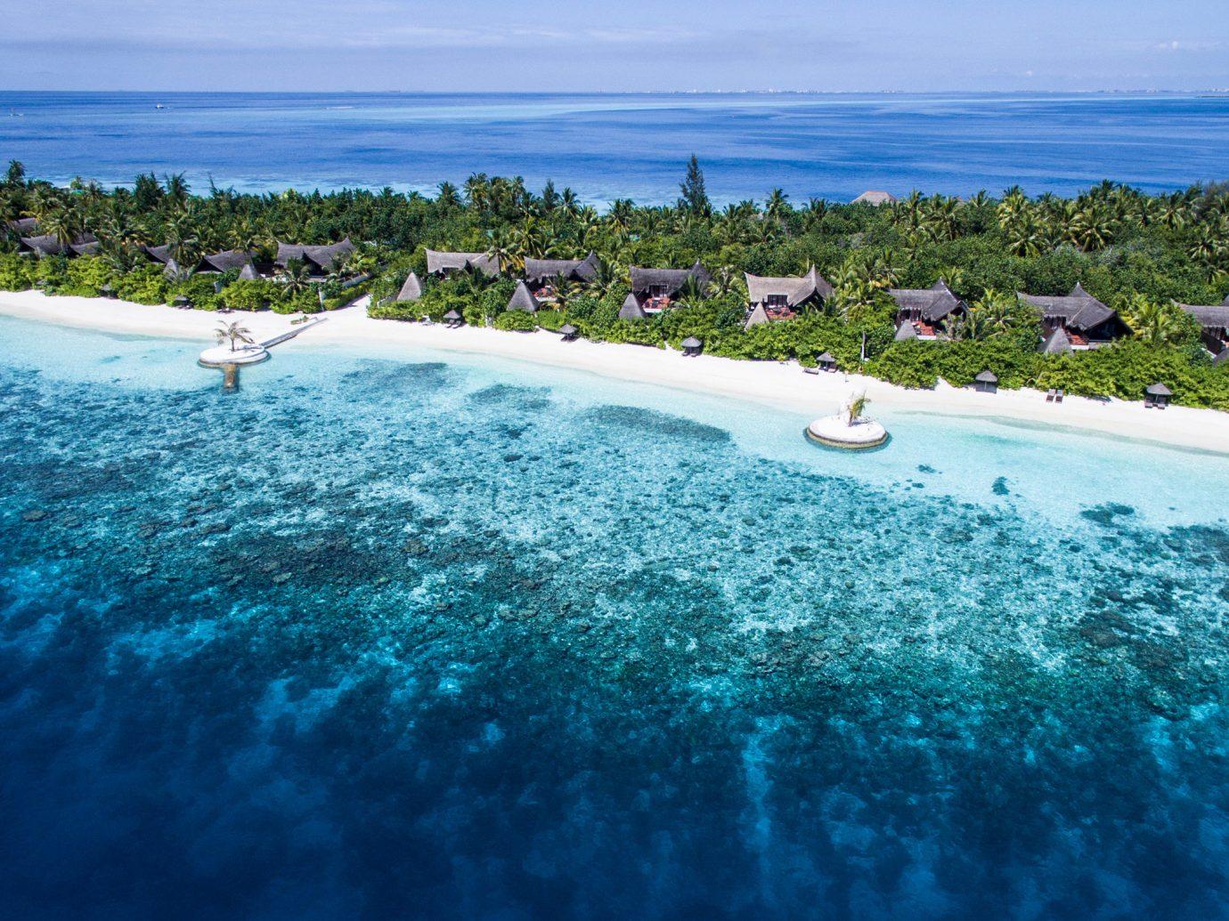 Hotels sky water Nature reef Sea outdoor Ocean shore horizon Beach caribbean swimming pool vacation Coast Lagoon bay Island wave cape tropics islet atoll archipelago day