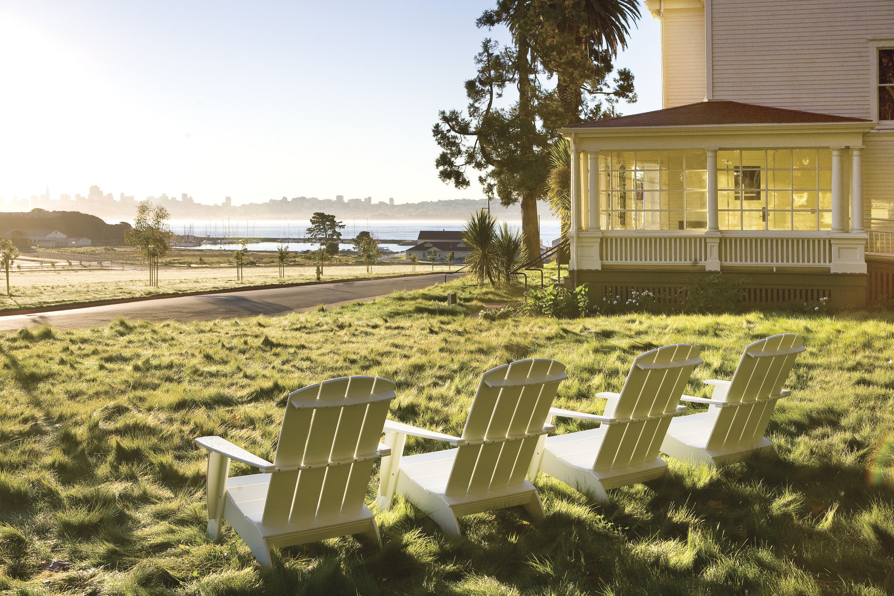 grass bench sky chair lawn tree residential area house home park suburb backyard yard outdoor structure overlooking Deck