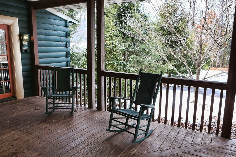 tree ground building porch property home cottage outdoor structure wooden backyard Deck surrounded