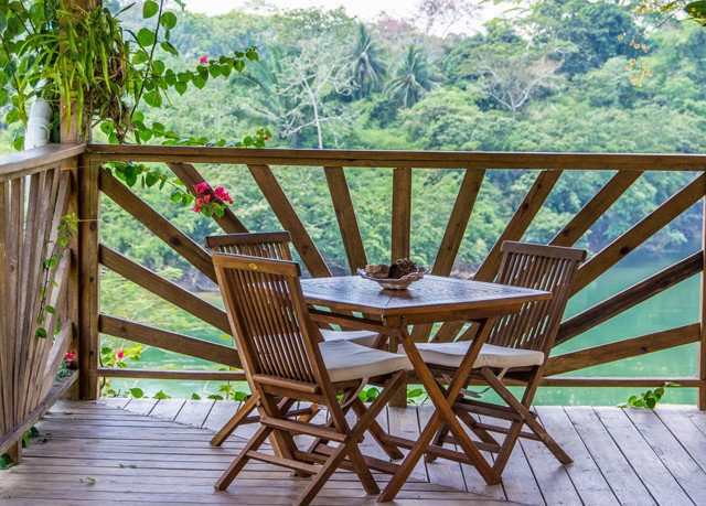 chair wooden outdoor structure porch cottage backyard Deck surrounded