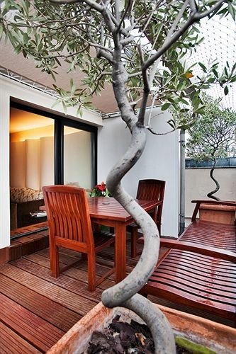 wooden tree home plant house porch outdoor structure sculpture backyard flower living room Deck