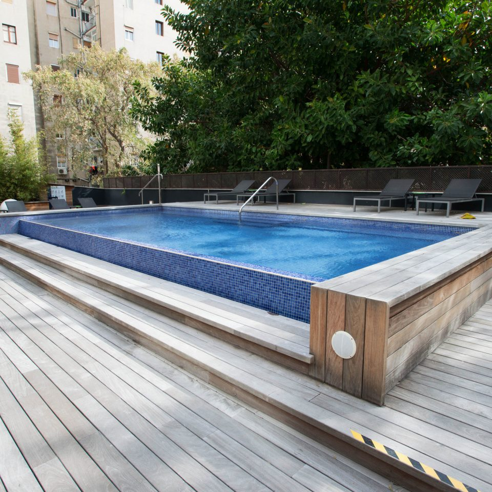 tree swimming pool property Deck wooden reflecting pool walkway outdoor structure platform backyard