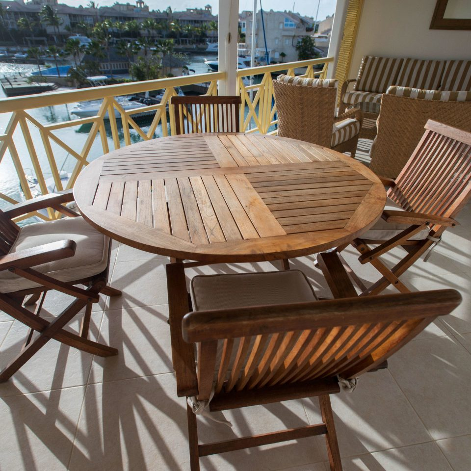chair wooden property Dining hardwood home outdoor structure cottage Deck dining table