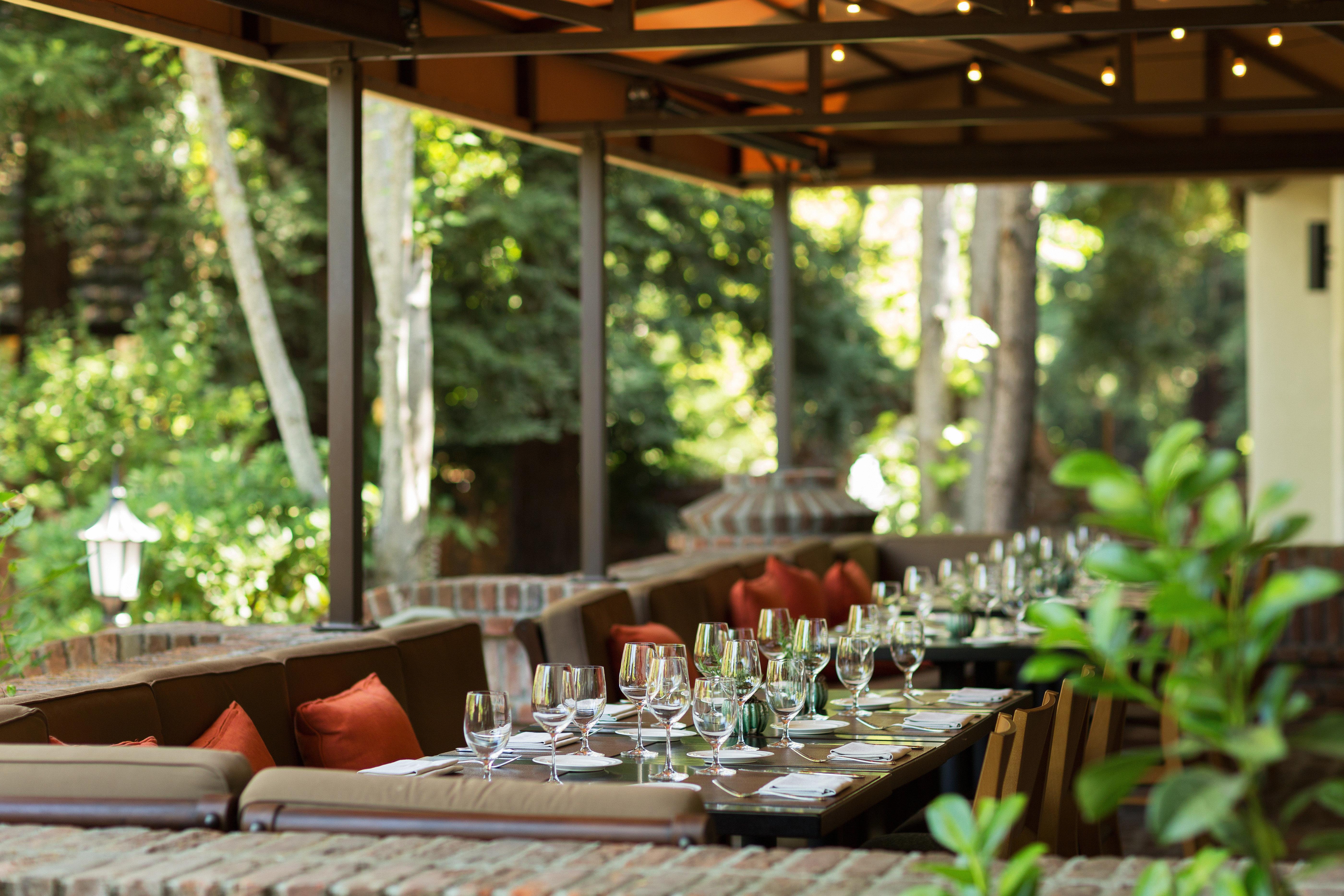 Deck Dining Drink Eat Inn Patio Romantic Terrace restaurant backyard Resort cottage outdoor structure rehearsal dinner dining table set