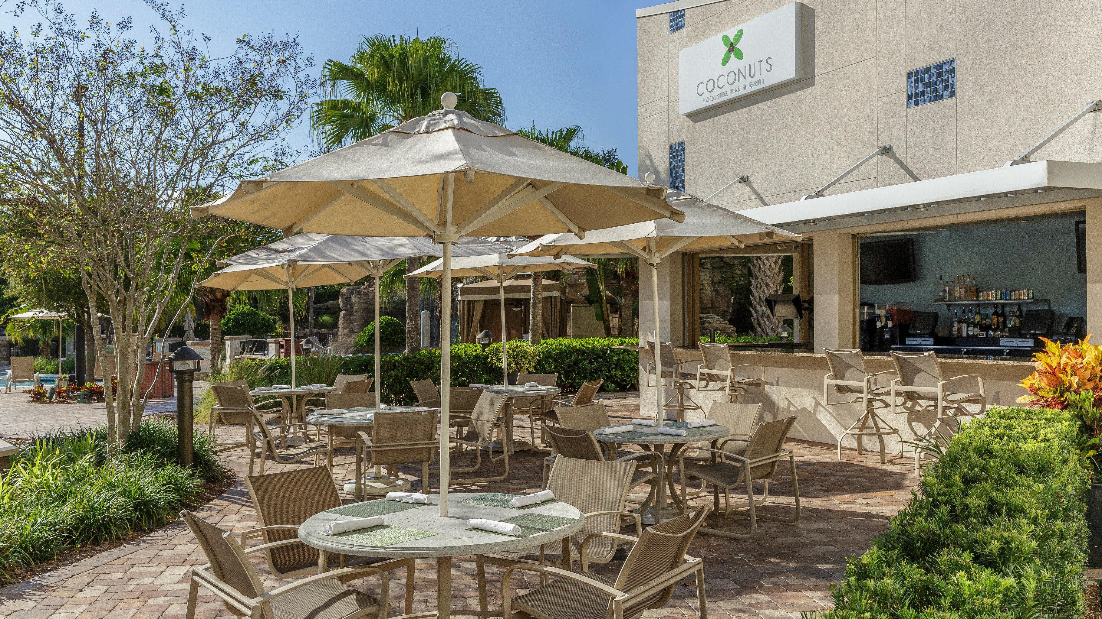 Dining Drink Eat Lounge tree ground chair building property Resort restaurant outdoor structure Villa Patio backyard Deck