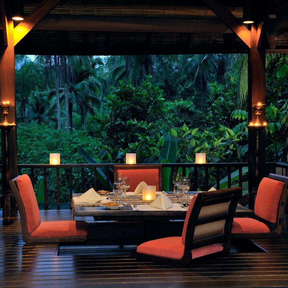 Deck Dining Elegant Romance Romantic Scenic views tree lighting living room Lobby Resort dining table
