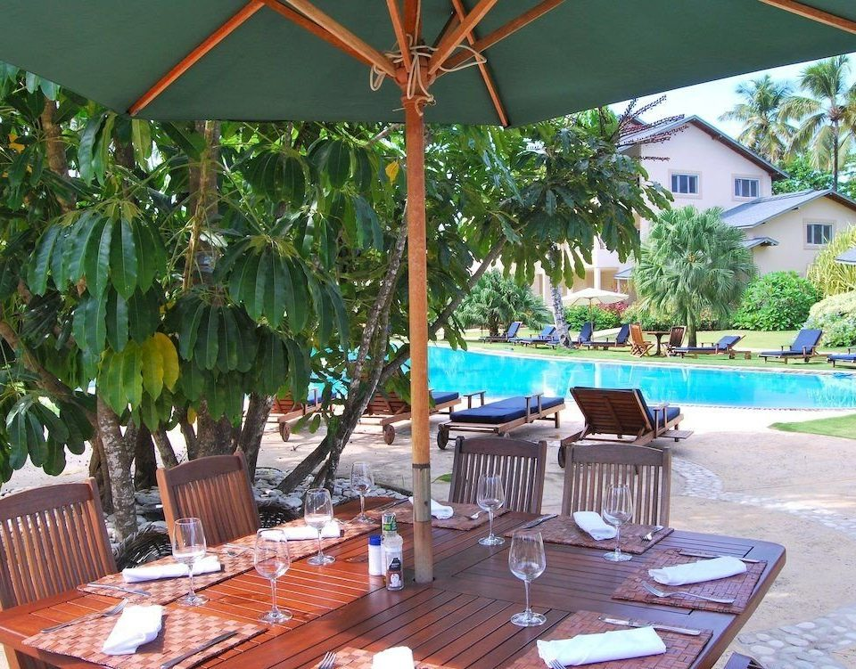 Exterior Lounge Pool tree umbrella chair property Dining Resort restaurant Villa backyard eco hotel hacienda swimming pool cottage caribbean set shade Deck