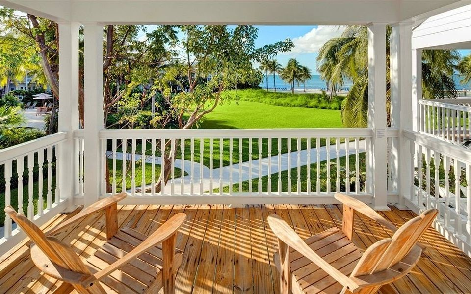 chair tree wooden porch building Dining property Deck outdoor structure home Villa cottage backyard Resort Garden