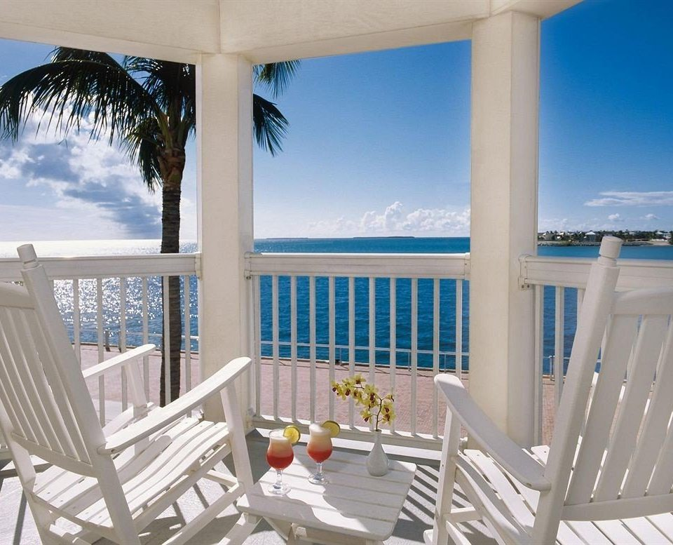 chair property Resort porch Ocean condominium caribbean Pool white Villa home overlooking Dining cottage swimming pool lawn Deck