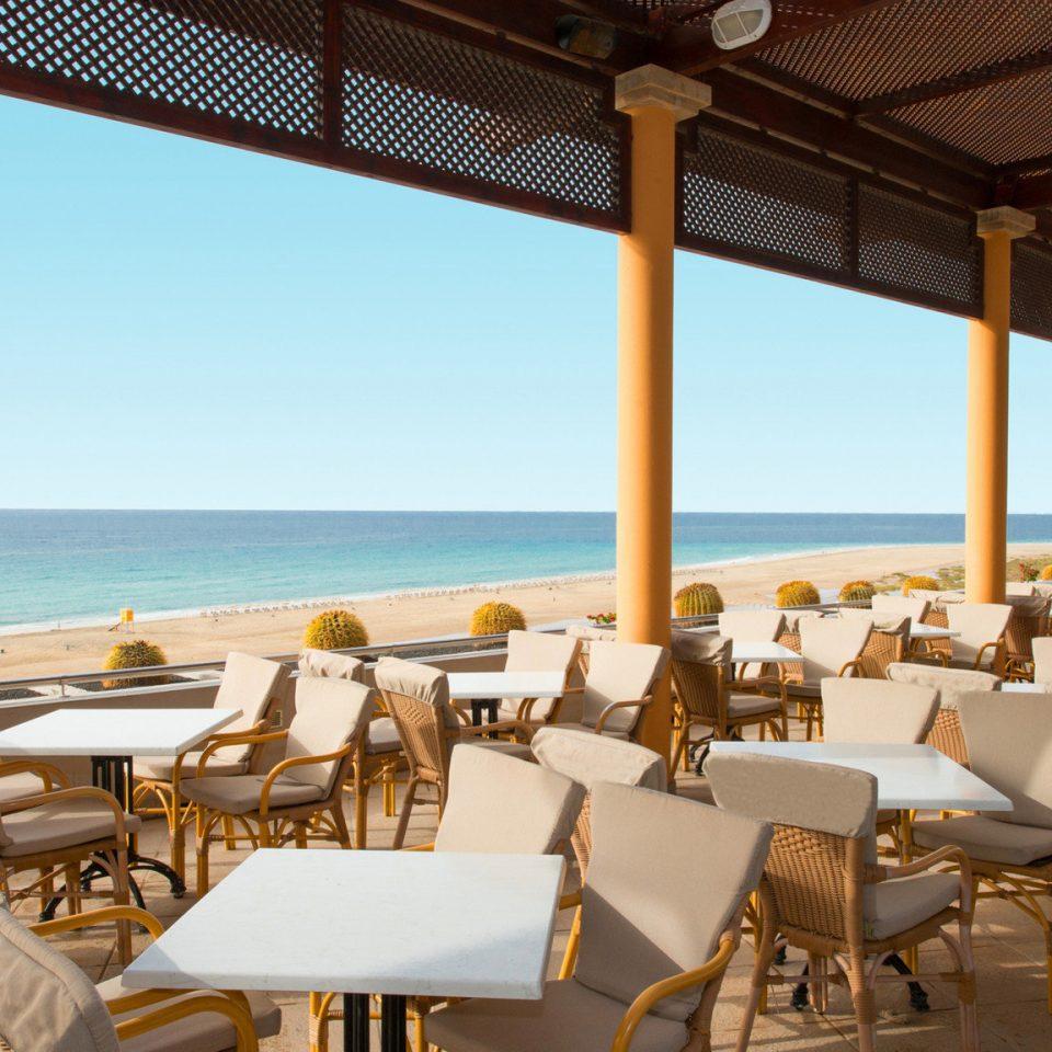 chair water leisure property Resort restaurant Dining Villa Ocean caribbean set Deck overlooking dining table
