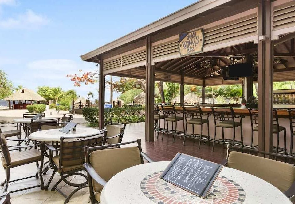 sky chair property building Resort home Villa condominium cottage Dining porch outdoor structure Patio Deck dining table