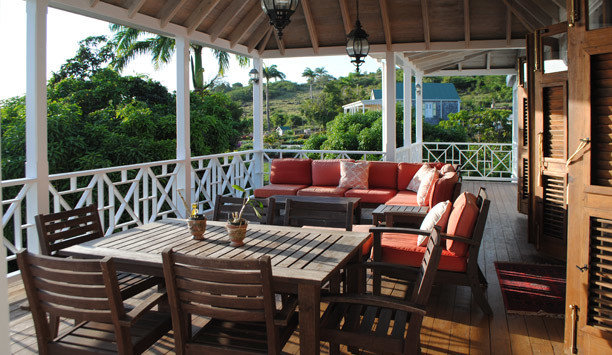 chair property building porch Dining outdoor structure Patio Deck house backyard Resort cottage dining table