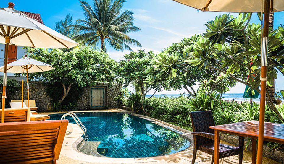 tree chair umbrella swimming pool leisure Resort property caribbean Pool Villa Dining lawn backyard shade eco hotel Deck tropics condominium porch set sunny