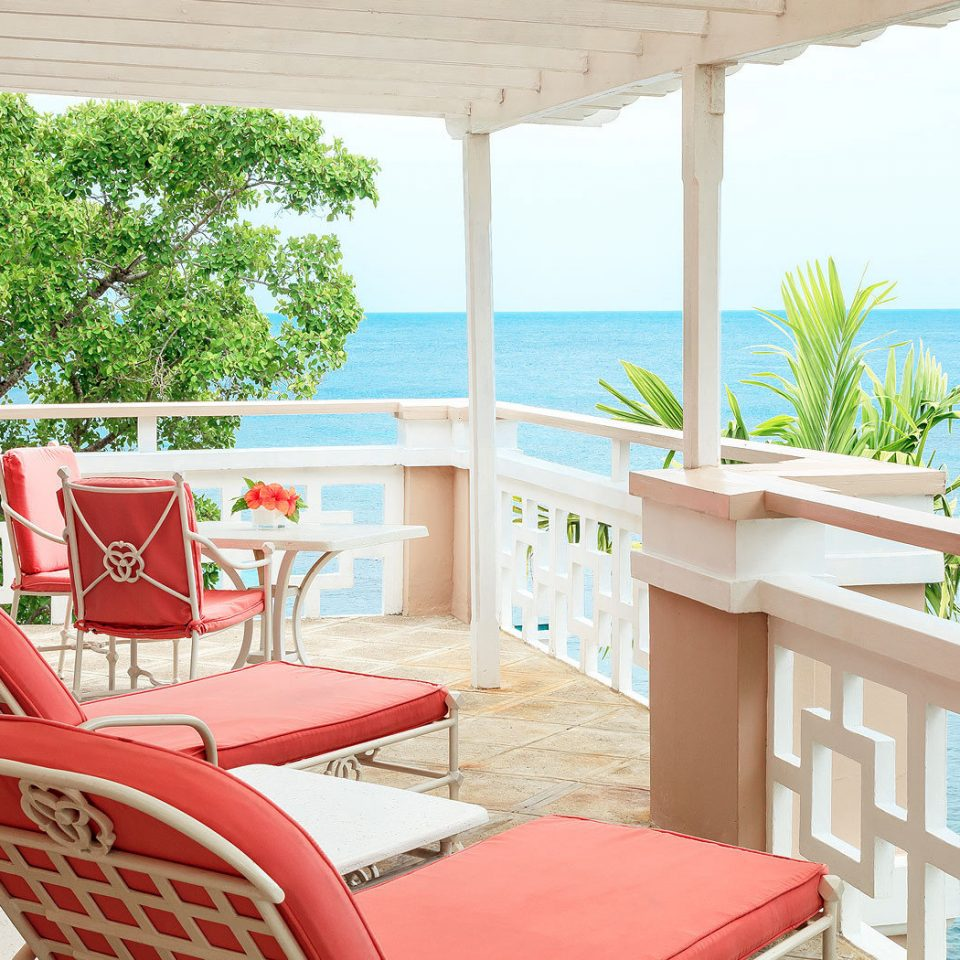 chair property home red condominium Resort cottage Dining Villa porch living room Deck
