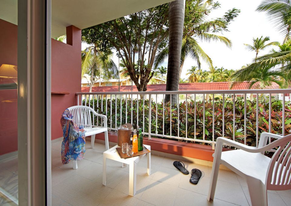 chair property Resort building home porch condominium Villa restaurant hacienda Dining Deck dining table