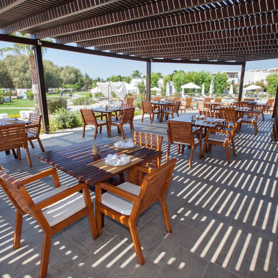 ground chair building property Resort porch outdoor structure restaurant Villa cottage Dining Deck