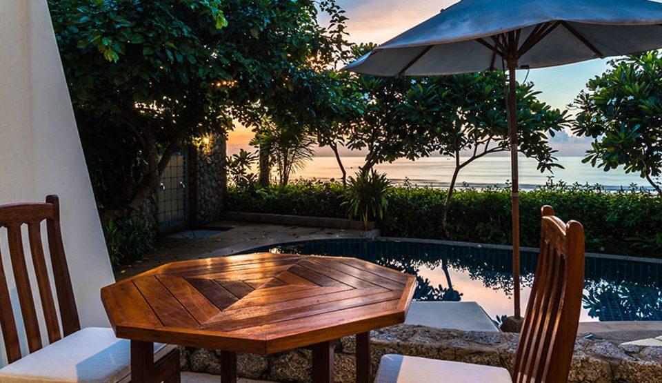 tree chair leisure Resort house wooden Dining swimming pool home Villa backyard set restaurant cottage porch Deck shade dining table surrounded day