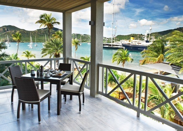 property chair Resort condominium Villa home porch cottage outdoor structure Dining overlooking Deck dining table