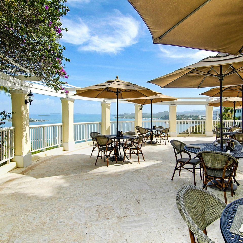 chair ground umbrella building property lawn home Resort cottage Villa porch restaurant Dining Deck shade