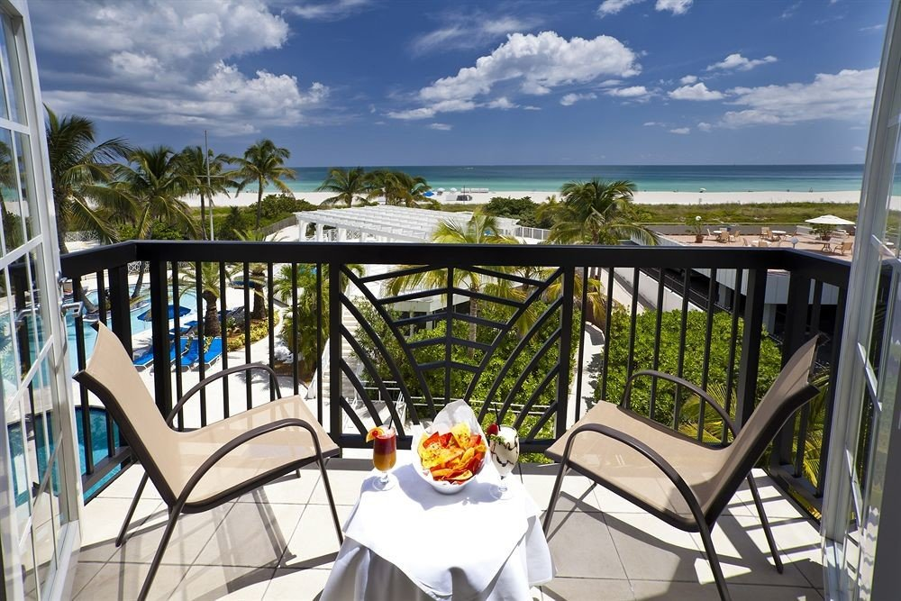 chair sky leisure property Resort Villa home Dining caribbean cottage overlooking Deck porch dining table