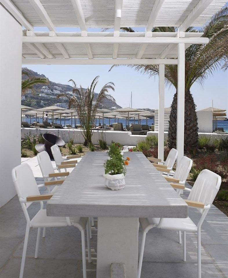 chair property building Dining white home restaurant outdoor structure Villa Deck