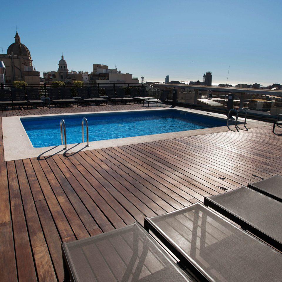 sky ground swimming pool property park pier wooden dock outdoor structure roof vehicle Deck empty railing walkway